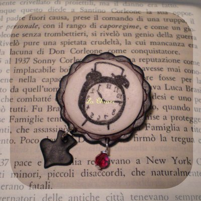 O'CLOCK brooch