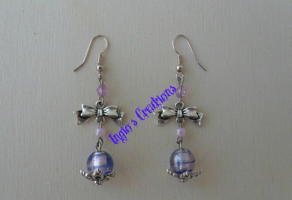 Orecchini con perle e fiocco