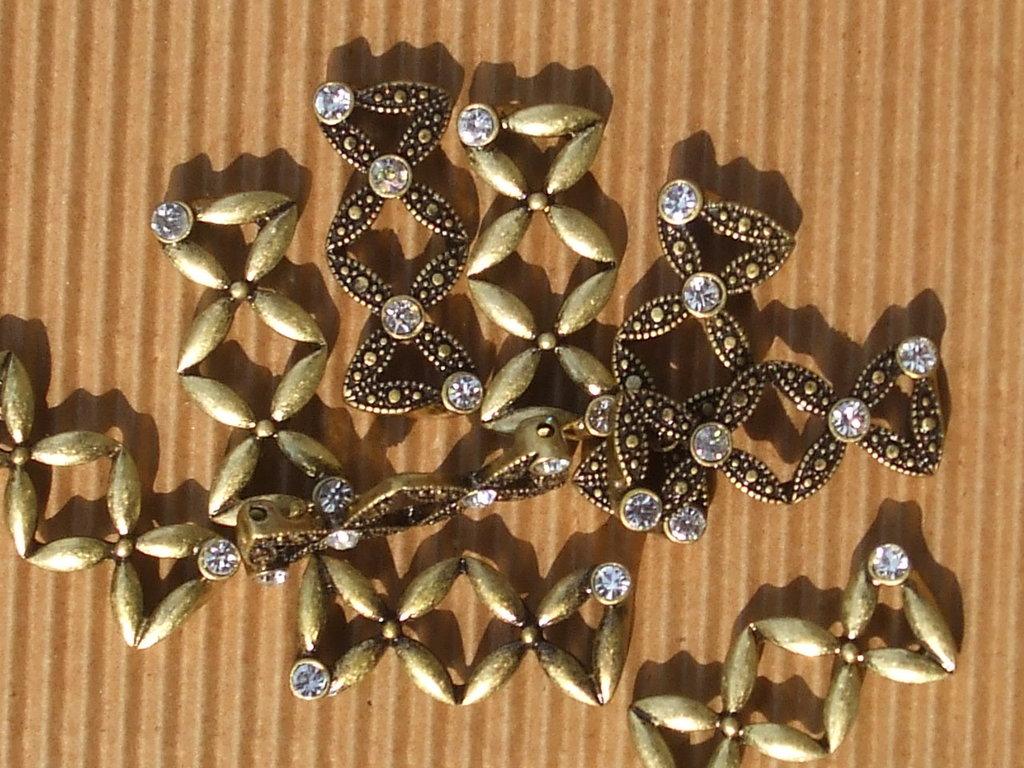9 moduli bracciale metallo dorato + strass vend.