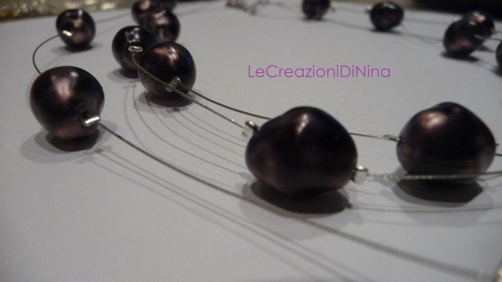 Collana cascata di perline viola