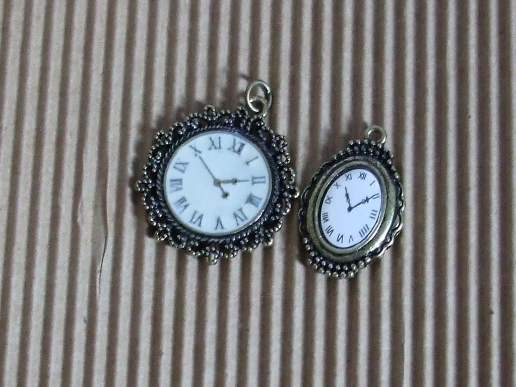 2 charms orologio vend.