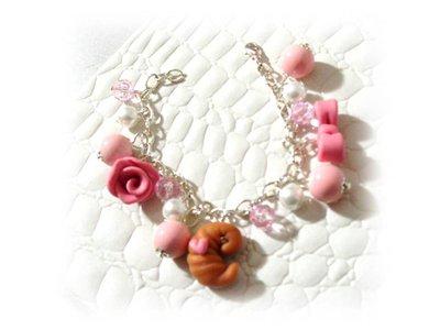 Bracciale croissant, fiocco, rosa- fimo