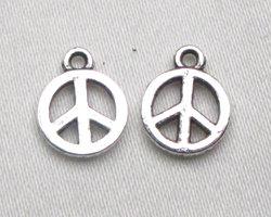 lotto da 5 charms simbolo pace argento tibetano 1cm