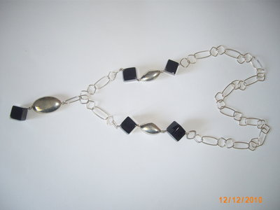 Collana in argento con cubi in onice.