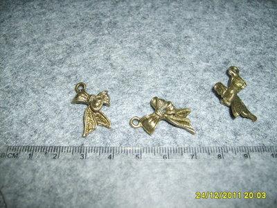 Lotto 4 pezzi charms fiocco bronzo