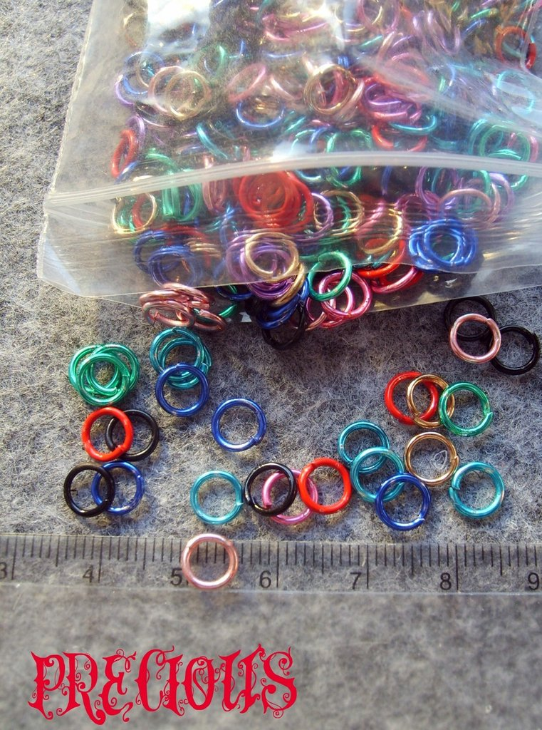 Lotto 100 pezzi anellini colorati