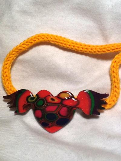 girocollo cuore alato