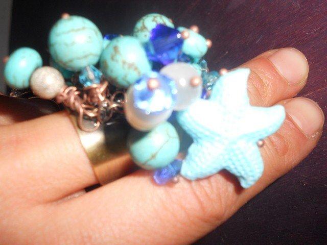 Anello con stella marina