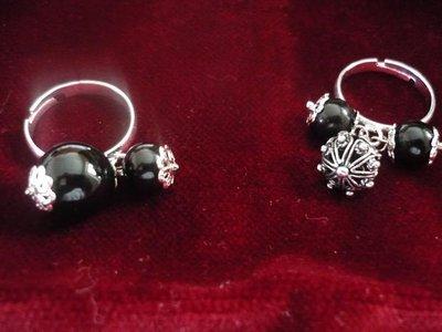 anello con onice nero,coccu e bottoni sardi