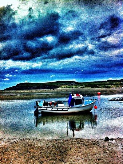 sad boat, blue sky
