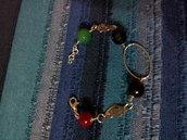 bracciale con cuori argentati e pietre colorate