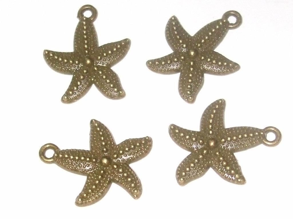 4 charms in bronzo stella marina vend.