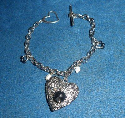 Bellissimo bracciale handmade in acciaio ciondoli in argento