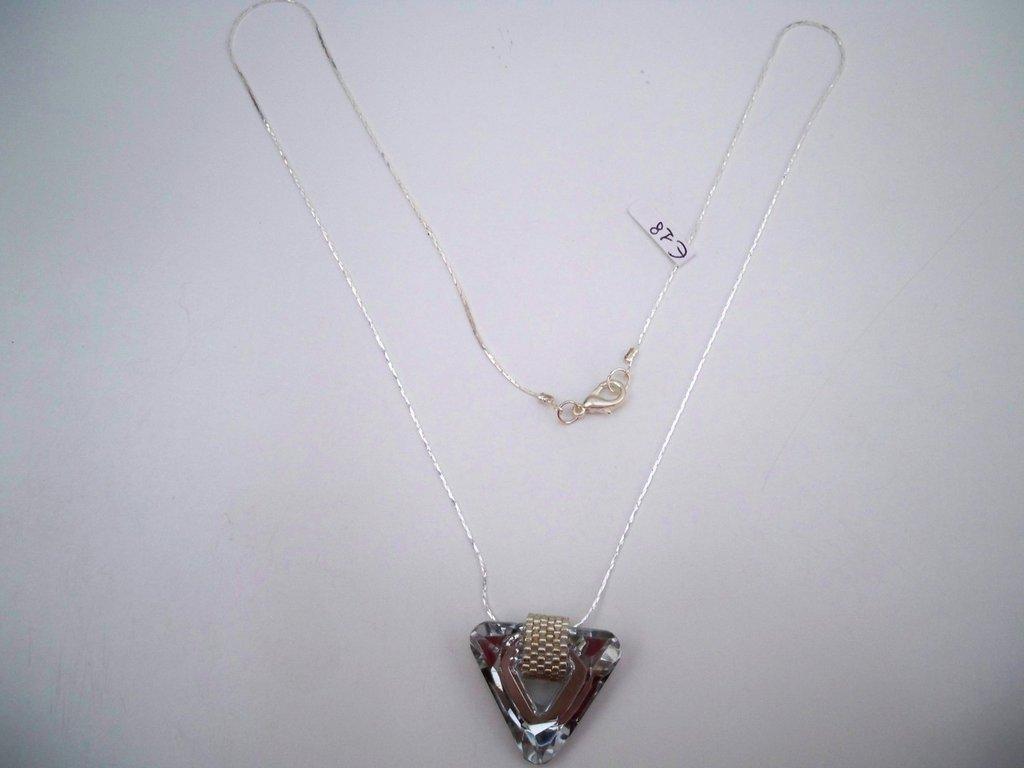 Collana con ciondolo triangolo trasparente e argento