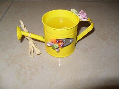 candela innaffiatoio