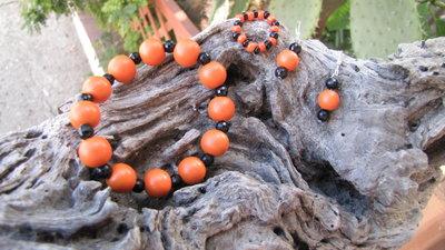 completo nero e arancione