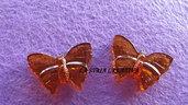 conf.2pz farfalla con foro passante