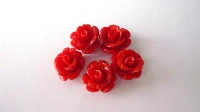 Roselline in corallo sintetico, rosso  Diametro: 11 mm.