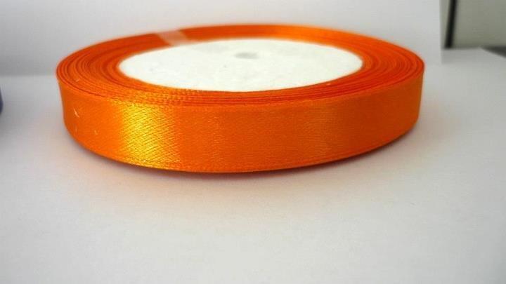 Fettuccia Satin Orange. Lunghezza rotolo 22,5 metri, spessore 12 mm.