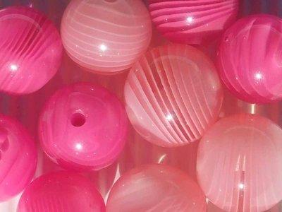 12 perle lucite rosa e fucsia di diverse misure vend.
