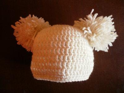 cappellino con ponpon