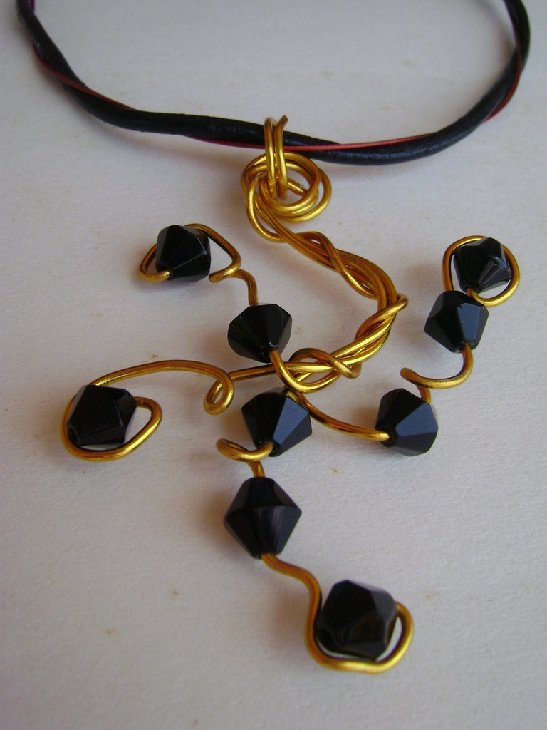 "Ciondolo ""black & gold"""