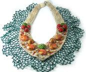 Collana realizzata a mano con base in crochet, frutta e borchie
