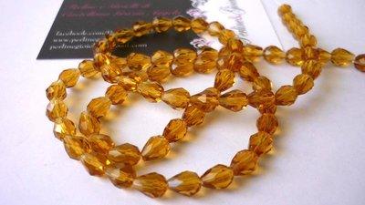 """Perle a goccia in vetro """"Suncatcher"""", sfaccettate, color ambra.  Dimensioni: 9 x 5 mm."""