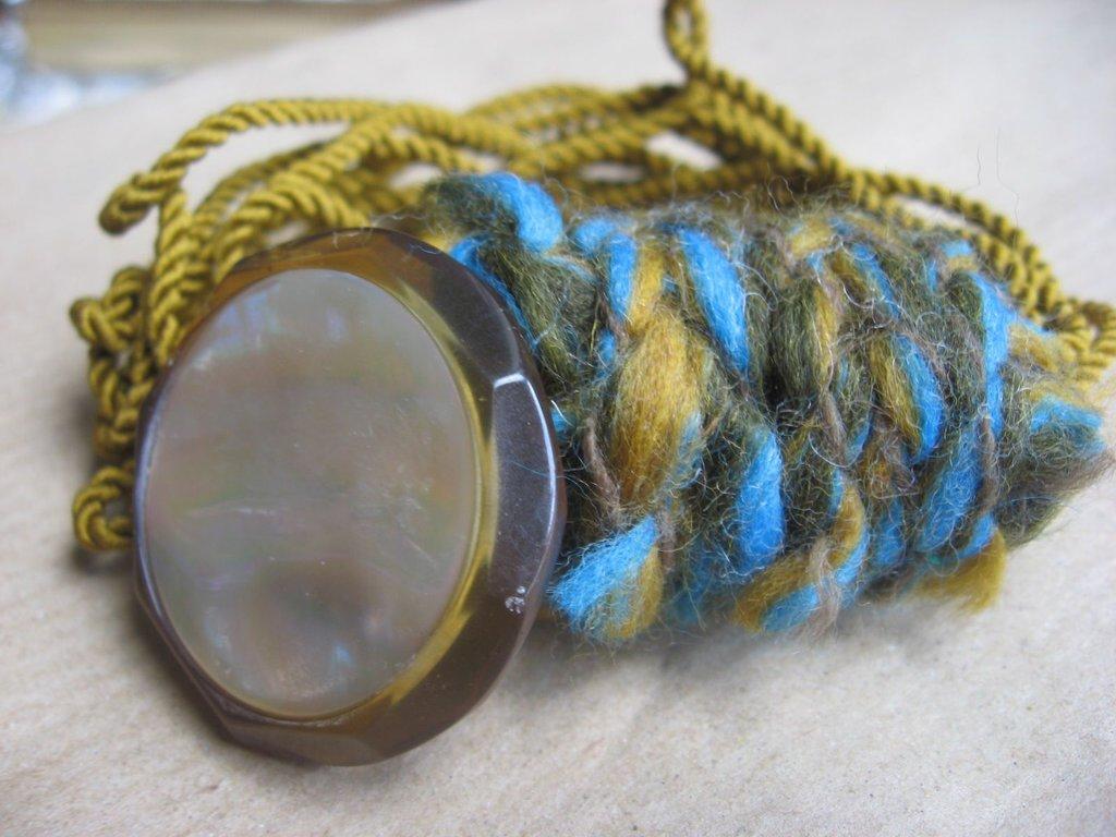 braccialetto con bottone