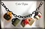 Bracciale con catena in seta nera e 5 borsine in miniatura