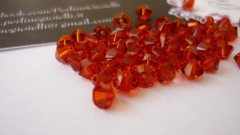 Swarovski® bicono 5301/5328, Indian Red  Diametro: 4 mm.
