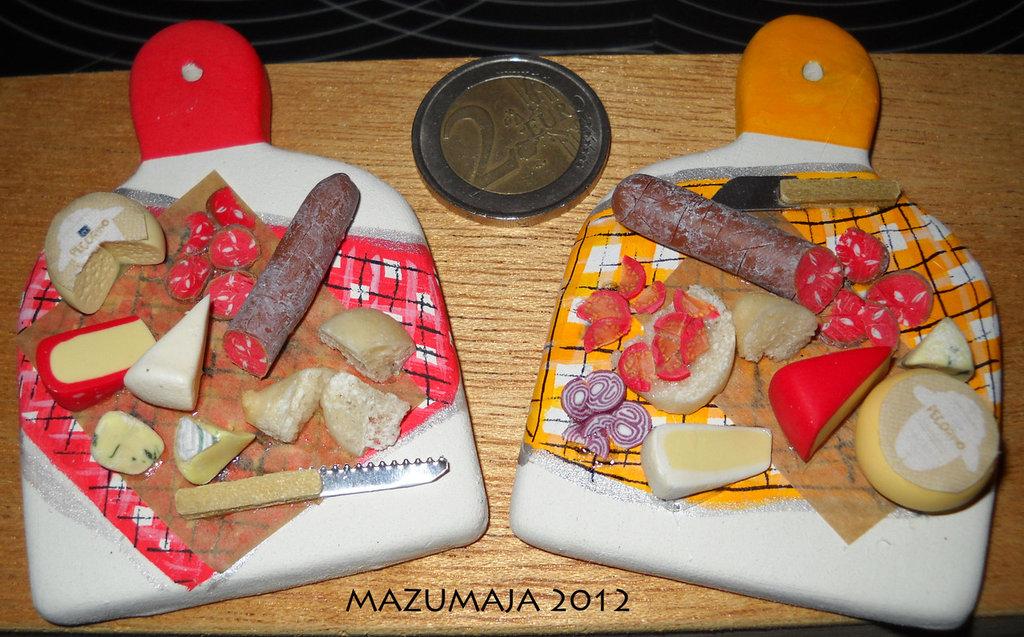 Miniatura tagliere con affettati e formaggi