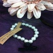 Bracciale con perle e ciondolo strass