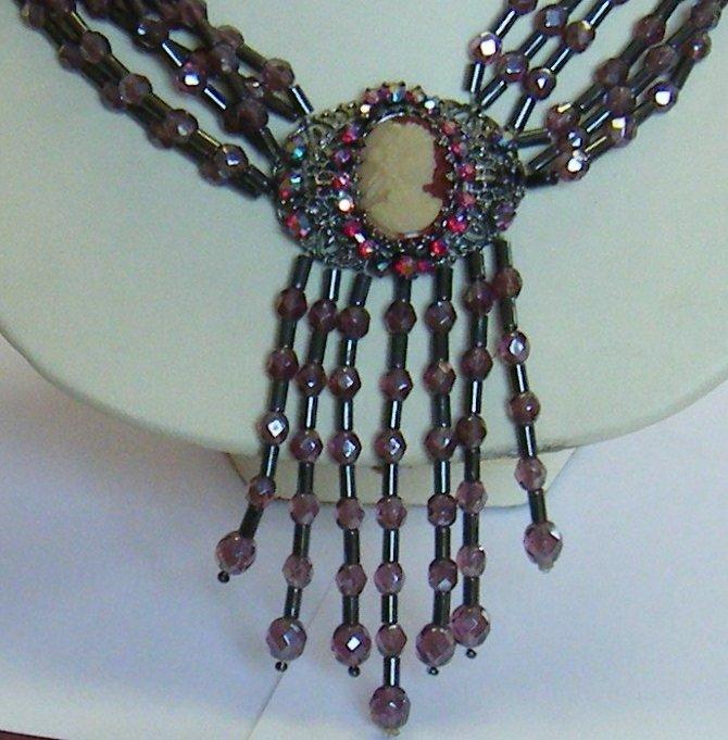 collana multifili con mezzo cristallo viola ,ematite e ciondolo cammeo,fatta a mano