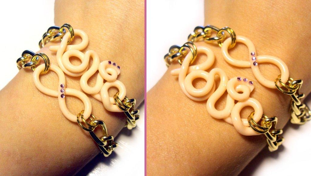 Bracciale catena dorata, simbolo infinito e scritta love, in fimo, con strass