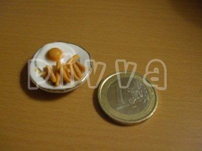 Uovo con patate fritte