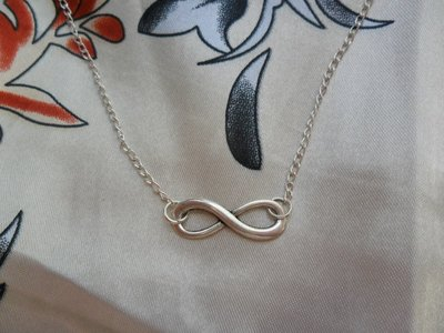 Collana INFINITO tono argento  o bronzo