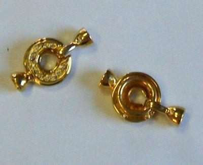 chiusura in metallo dorato e strass