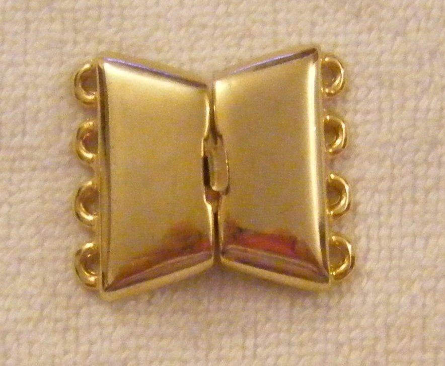 chiusura a 4 fili in metallo dorato