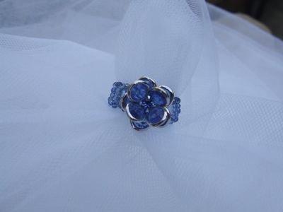 Anello con cristalli Swarovski a forma di fiore color azzurro - cod. E6