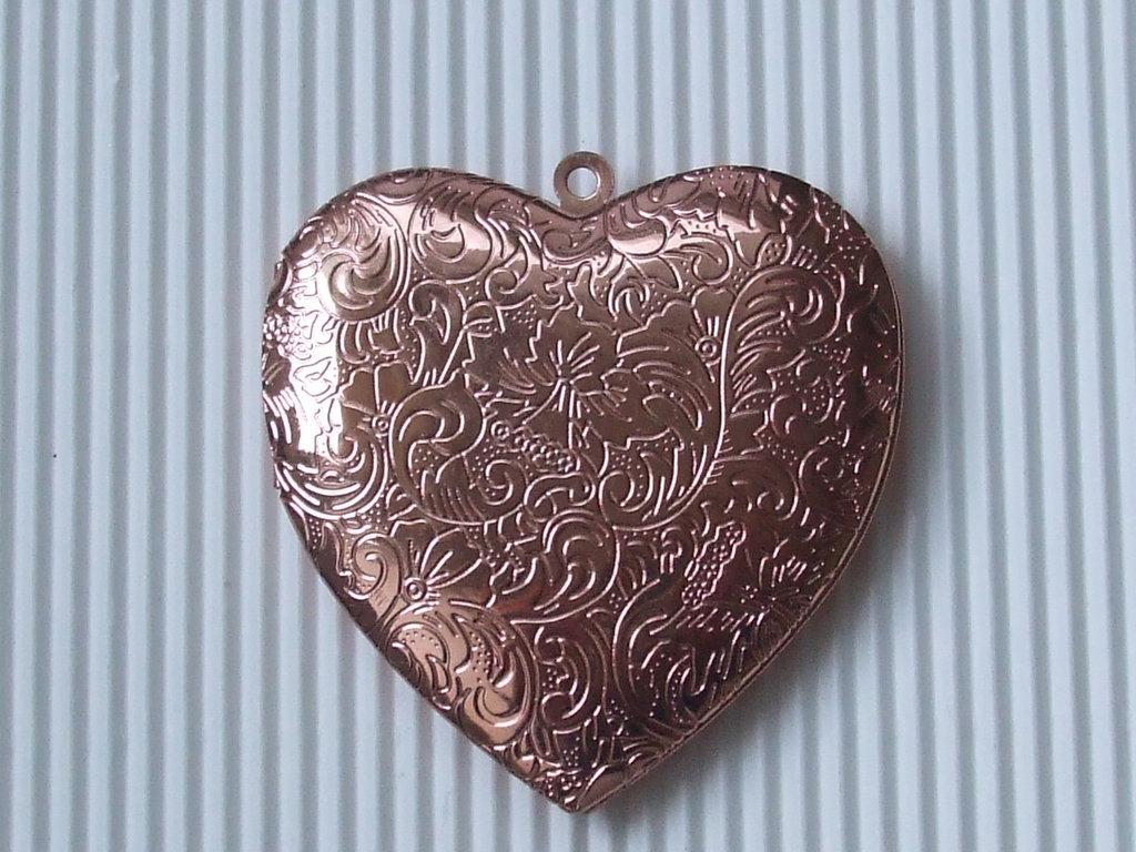 1 maxi medaglione apribile cuore vend.