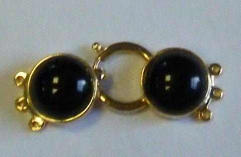 chiusura a 3 fili in metallo dorato e perla cabochon