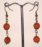 Orecchini in giada arancio con doppia pietra            pietre