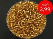 conteria economica in vetro, 6/0, linea dorata. pacco 440 gr.