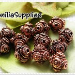 4 PZ PERLE IN METALLO DECORATO BALI BEADS STYLE 10X9mm - COLOR RAME