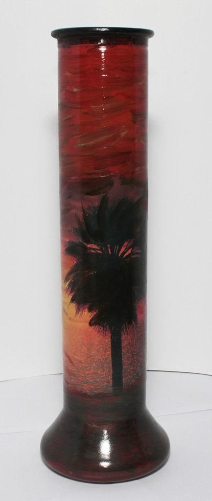 Grande vaso di vetro con palma