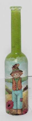 Bottiglietta porta essenze con spaventapasseri  e sfondo verde