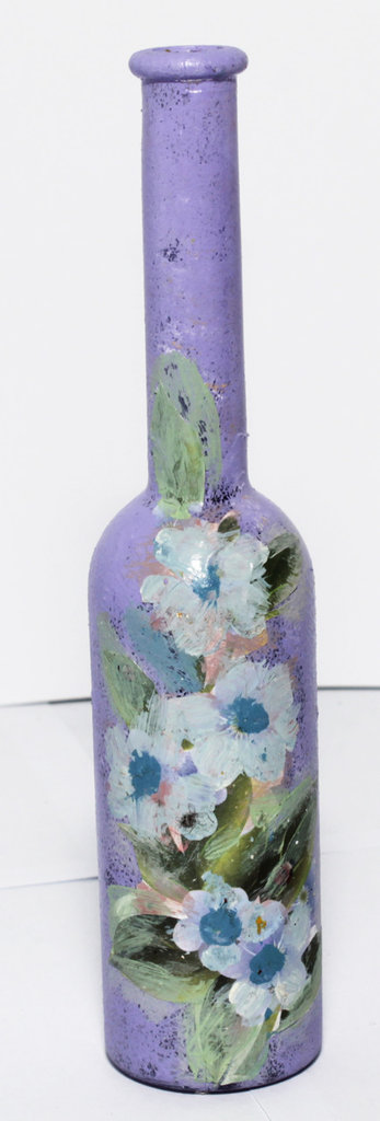 Bottiglietta porta essenze con fiori e sfondo lilla