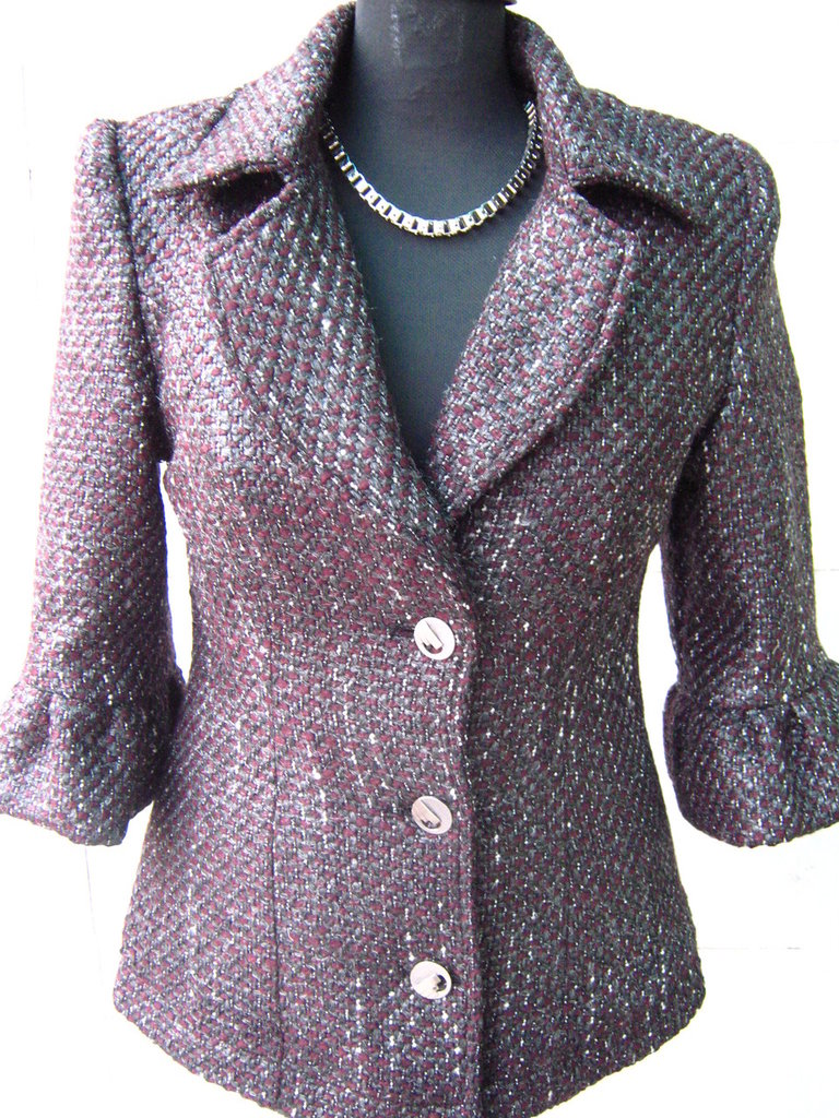 Cappotto del rivestimento delle donne alla moda