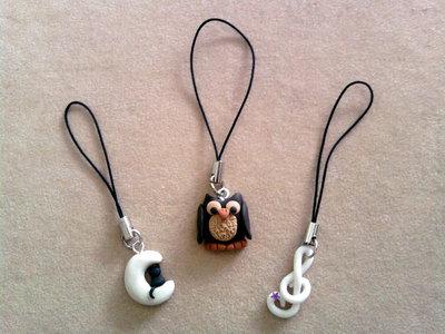 Phonestraps con luna fluo con gatto, gufo e chiave musicale fimo